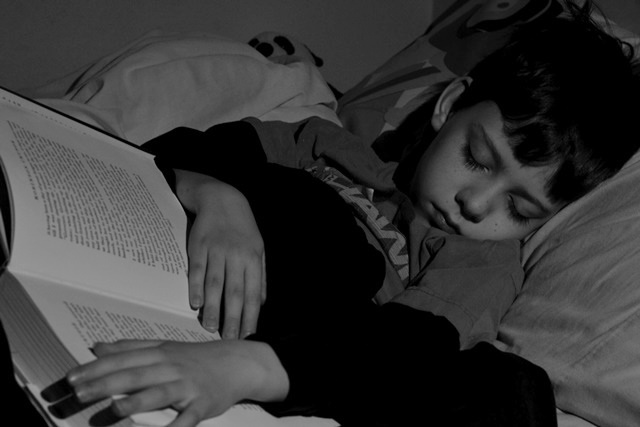 John sleeping with book brighter